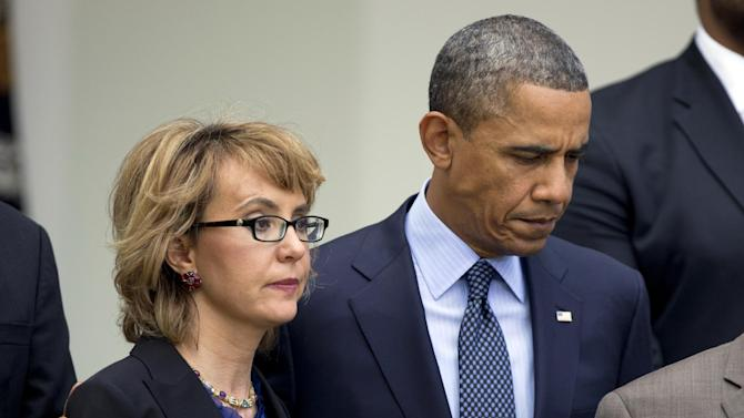 President Barack Obama, right, puts his arm around former Rep. Gabrielle Giffords, D-Ariz., before he speaks in the Rose Garden at the White House in Washington, Wednesday, april 17, 2013, about measures to reduce gun violence.  (AP Photo/Manuel Balce Ceneta)