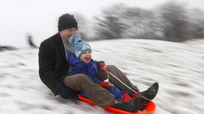 FILE - In this Saturday, Jan. 21, 2012, file photo, Matt Redmond, 3, and his father, Mike, ride a sled down a hill after an overnight snowfall in Baltimore. According to a government survey released on Friday, Dec. 20, 2013, the detached dad is mostly a myth. Most American fathers say they are heavily involved in hands-on parenting, the researchers found. The nationally representative survey shows fathers' involvement has increased slightly since the government first asked in 2002, coinciding with research since then that bolsters the benefits of hands-on fathering. (AP Photo/Patrick Semansky, File)