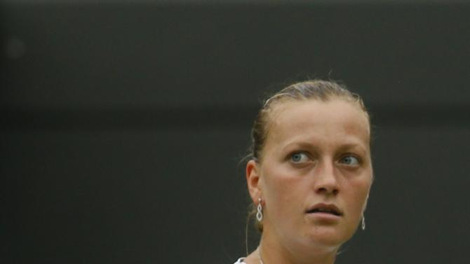 Petra Kvitova of Czech Republic reacts after scoring a point to Ekaterina Makarova of Russia during their Women's singles match at the All England Lawn Tennis Championships in Wimbledon, London, Friday, June 28, 2013. (AP Photo/Kirsty Wigglesworth)
