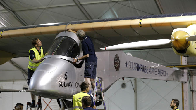 The aircraft Solar Impulse is prepared for the second leg of the 2013 Across America mission, early Wednesday, May 22, 2013, at Sky Harbor International Airport in Phoenix. The solar powered aircraft is scheduled to land at Dallas/Fort Worth International Airport on Thursday May 23. The plane's creators, Bertrand Piccard and Borschberg, said the trip is the first attempt by a solar airplane capable of flying day and night without fuel to fly across America. (AP Photo/Matt York)