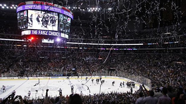 Los Angeles Kings players and their fans celebrate after they defeated the New Jersey Devils in Game 6 of the NHL Stanley Cup finals (Reuters)