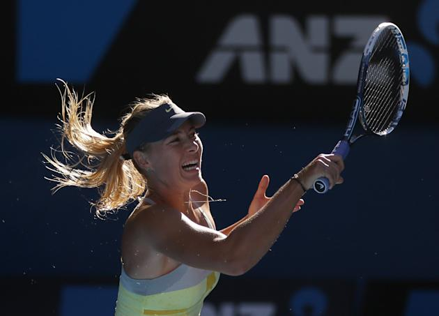 Russia's Maria Sharapova hits a return to compatriot Ekaterina Makarova during their quarterfinal match at the Australian Open tennis championship in Melbourne, Australia, Tuesday, Jan. 22, 2013. (AP