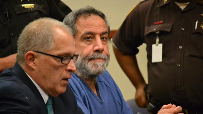 Mahmoud Yousef Hindi, who is charged with killing two people at a Louisville homeowners association meeting in September, sits with his attorney, Mike Lemke, on Friday, Nov. 2, 2012 in Lousiville, Ky.   Prosecutors say they will seek the death penalty for Hindi if he is convicted on two counts of murder. (AP Photo/Dylan Lovan)