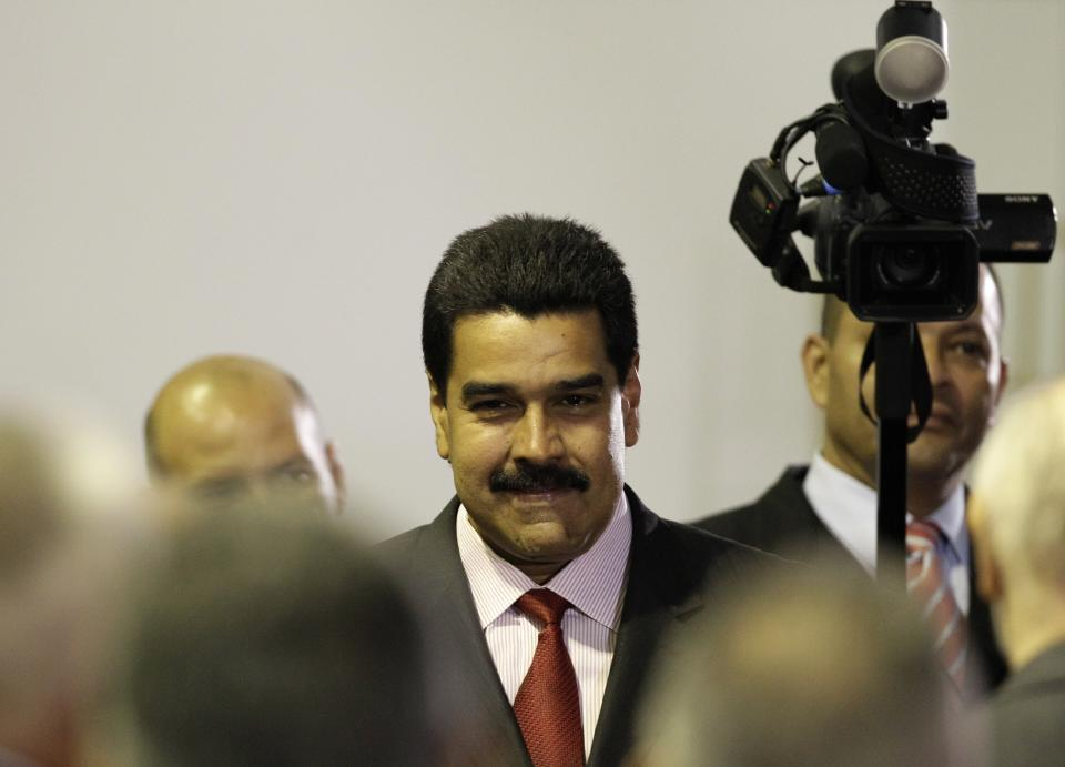 Venezuela's long time Foreign Minster Nicolas Maduro attends a ceremony declaring President Hugo Chavez official winner of Sunday's presidential elections at the Electoral Council in Caracas, Venezuela, Wednesday, Oct. 10, 2012. During the event Chavez announced he was naming Maduro as new vice president. (AP Photo/Ariana Cubillos)
