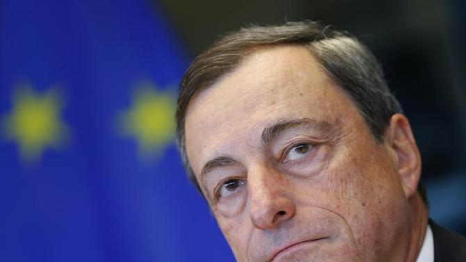 ECB President Draghi waits for the start of the European Parliament's Economic and Monetary Affairs Committee meeting in Brussels