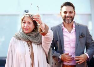 """Director Banietemad and actor Moadi arrive at the red carpet for the movie """"Ghesseha (Tales)"""" at the 71st Venice Film Festiva"""