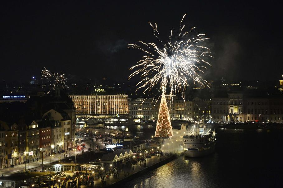 Fireworks explode over Skepsbron street during New Year's Eve celebrations in central Stockholm