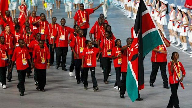 The Kenyan Olympic team holding the national flag