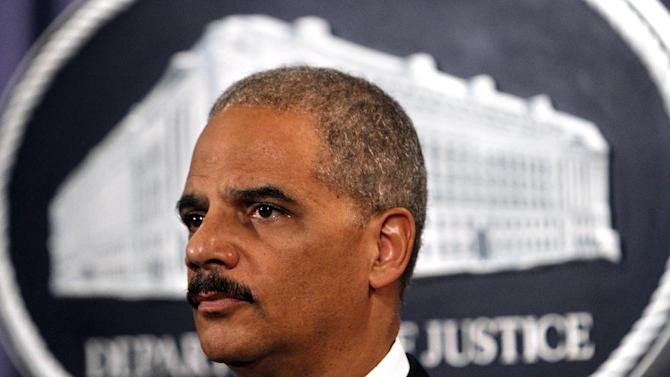 FILE - In this Sept. 7, 2011 file photo, Attorney General Eric Holder listens to a question about Medicare fraud enforcement at the Justice Department in Washington. Holder says an investigation of arms traffickers called Operation Fast and Furious was flawed in concept as well as in execution and never should have occurred. Facing tough questioning by Senate Republicans about the operation, He says he wants to know why and how firearms that should have been under surveillance could wind up in the hands of Mexican drug cartels. (AP Photo/Jacquelyn Martin, File)