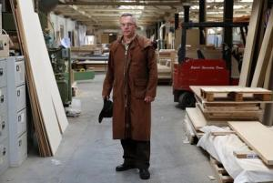 Factory landlord Taylor poses in the factory he rents to Enfield Speciality Doors in Enfield in north London