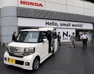 The Honda N Box Plus mini-vehicle parked outside the company's headquarters in Tokyo. Honda Motor blamed human error for Monday's release of its financial results several hours before schedule, sparking a stock market frenzy