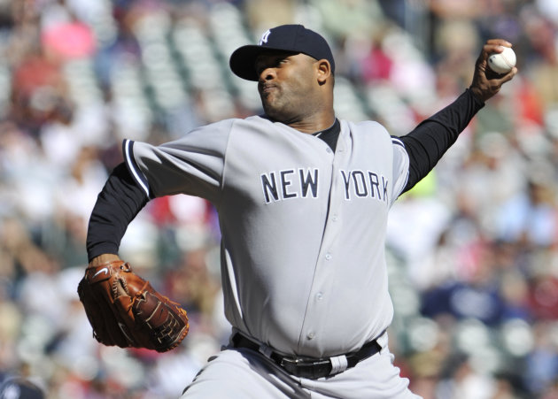 New York Yankees pitcher CC Sabathia throws against the Minnesota Twins during the first inning of a baseball game, Wednesday, Sept. 26, 2012 in Minneapolis. (AP Photo/Jim Mone)