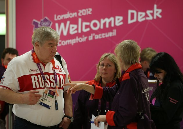 LONDON, ENGLAND - JULY 16: A Russian Olympic team official is given assistance at Heathrow Airport on July 16, 2012 in London, England. Athletes, coaches and Olympic officials are beginning to arrive