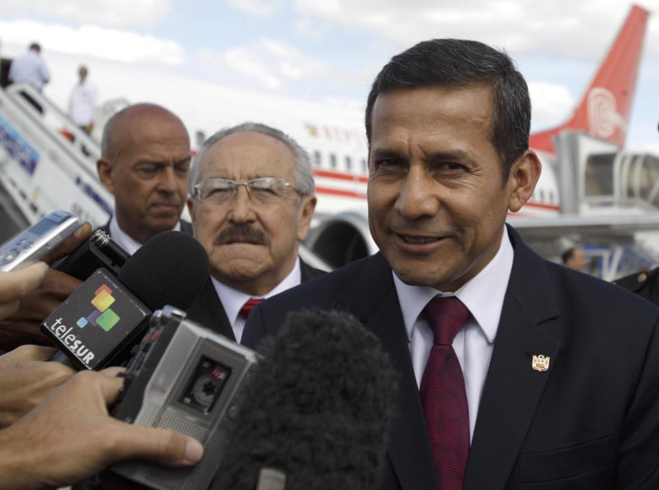 Peru's President Ollanta Humala speaks with journalists after arriving to the Jose Marti international airport in Havana, Cuba, Friday, Jan. 11, 2013. Humala arrived to Cuba to visit Venezuela's President Hugo Chavez, who is recovering from cancer surgery. (AP Photo/Franklin Reyes)