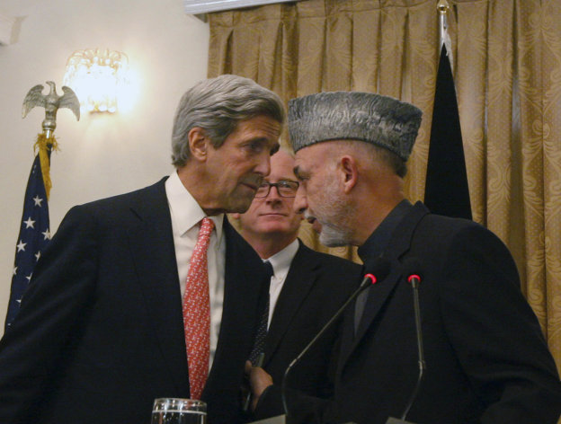 FILE - In this Oct. 20, 2009 file photo, Afghan President Hamid Karzai, right, whispers with the U.S. Sen. John Kerry, D-Mass, left, as Kai Eide head of the United Nations Assistance Mission in Afghanistan is seen, center, during a press conference, in Kabul, Afghanistan on Tuesday, Oct. 20, 2009. Kerry, President Barack Obama's choice for secretary of state, is a familiar face to the world leaders vital to American interests. (AP Photo/Musadeq Sadeq)