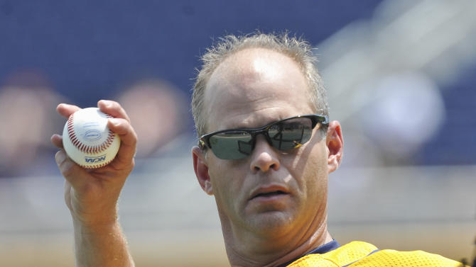 Kent State coach Scott Stricklin throws during batting practice in Omaha, Neb., Thursday, June 14, 2012. Kent State is scheduled to play Arkansas on Saturday in an NCAA College World Series baseball game. (AP Photo/Dave Weaver)