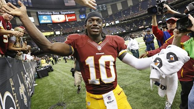 Washington Redskins quarterback Robert Griffin III (10) is congratulated by fans after his team defeated the New Orleans Saints during their NFL football game in New Orleans (Reuters)