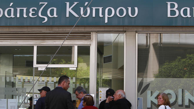 Cyprus banks re-open; limits on transactions