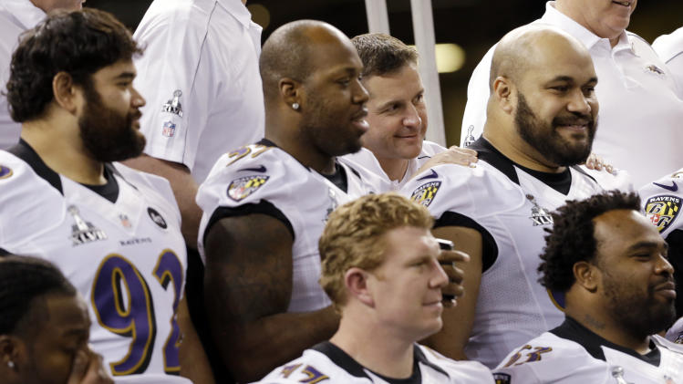 Baltimore Ravens head coach John Harbaugh poses for a team picture with his players during media day for the NFL Super Bowl XLVII football game Tuesday, Jan. 29, 2013, in New Orleans. (AP Photo/Pat Semansky)