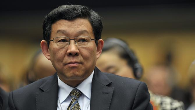 Chinese Commerce Minister Chen Deming, attends  the opening day of the 8th Ministerial Conference of the World Trade Organisation (WTO) in Geneva, Switzerland, Thursday, Dec. 15, 2011. The 153-member World Trade Organisation (WTO) is holding its eighth ministerial conference in its Geneva base from Dec. 15 to Dec. 17. (AP Photo/Keystone/Martial Trezzini)