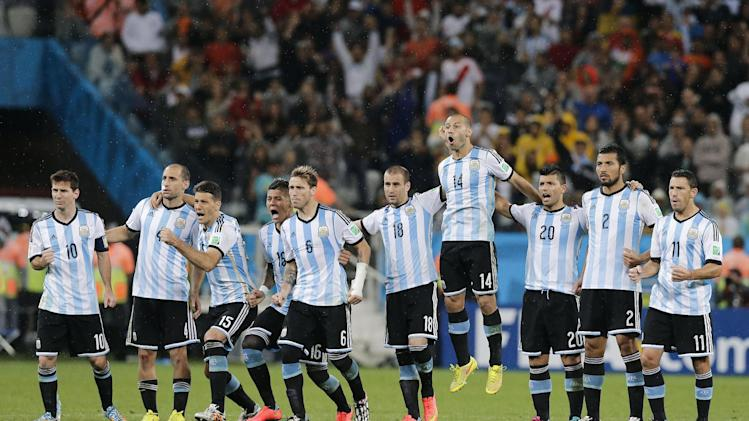 Argentine players react during a penalty shoot-out in the World Cup semifinal soccer match between the Netherlands and Argentina at the Itaquerao Stadium in Sao Paulo Brazil, Wednesday, July 9, 2014. Argentina defeated the Netherlands 4-2 in a penalty shootout after a 0-0 tie after extra time to advance to the finals against Germany