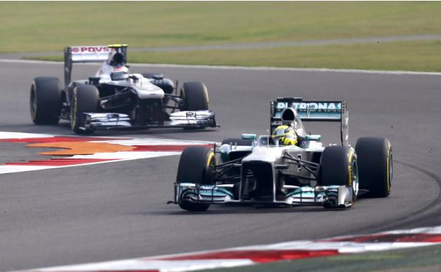 Mercedes Formula One driver Rosberg and Williams Formula One driver Bottas drive during the qualifying session of the Indian F1 Grand Prix at the Buddh International Circuit in Greater Noida