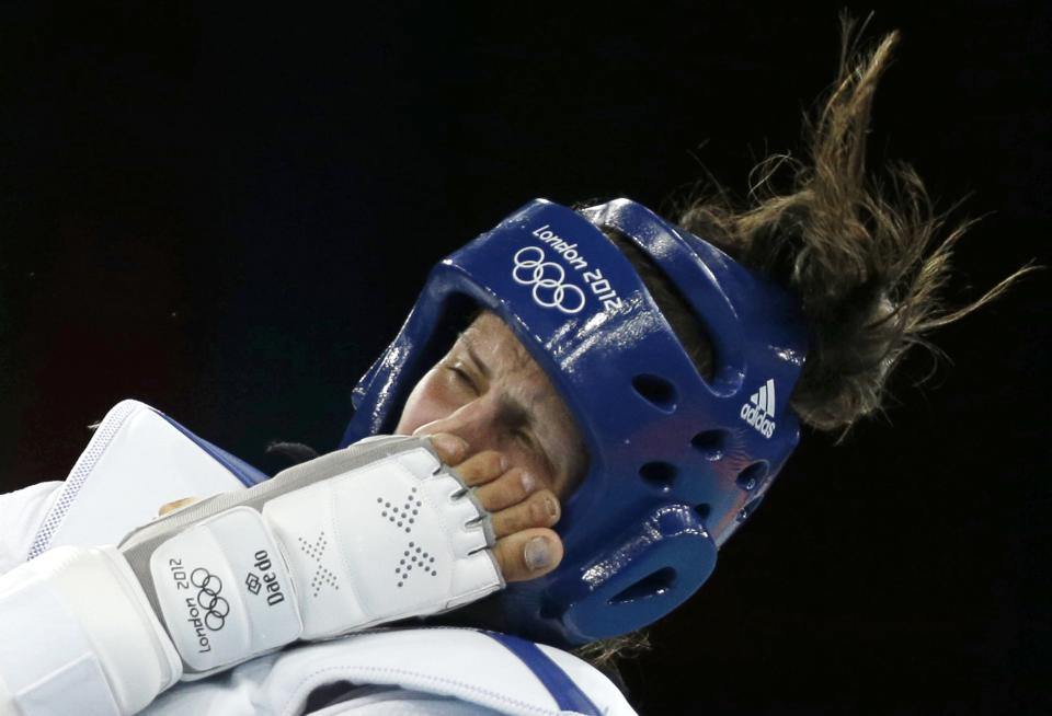 Jordan's Nadin Dawani is kicked in the face by Ukraine's Maryna Konieva during their match in women's plus 67-kg taekwondo competition at the 2012 Summer Olympics, Saturday, Aug. 11, 2012, in London. (AP Photo/Ng Han Guan)