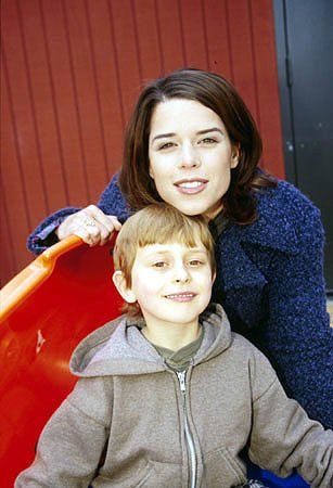Neve Campbell, star of The Craft and all those Scream movies, with a kid named David Dorfman