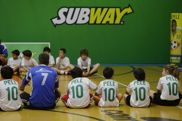 Children wait the arrive of former U.S. Olympic Swimmer Michael Phelps and Brazilian soccer legend Pele at Competition academy, during a event organized by SUBWAY restaurants, on Wednesday, Dec. 4, 20