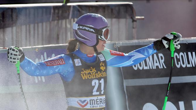 Slovenia's Tina Maze reacts at the finish area after taking fourth place in in an alpine ski, women's World Cup downhill race, in Meribel, France, Saturday, Feb. 23, 2013. (AP Photo/Enrico Schiavi)