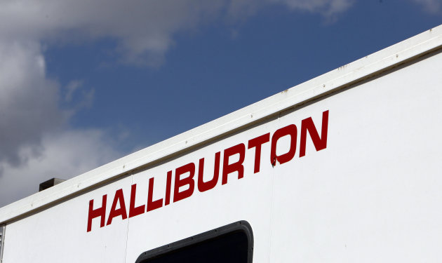 FILE - In this April 15, 2009 file photo, the Halliburton sign adorns the side of a machine being used by the company at a site for natural-gas producer Williams in Rulison, Colo. Halliburton Co.'s net income was flat in the second quarter as a slowdown in North American drilling offset an increase internationally. The Houston oil and natural gas services firm on Monday reported net income of $737 million, or 79 cents per share, from April to June. That compared with $739 million, or 80 cents per share, for the same period of 2011. Revenue increased 22 percent to $7.23 billion. (AP Photo/David Zalubowski, File)