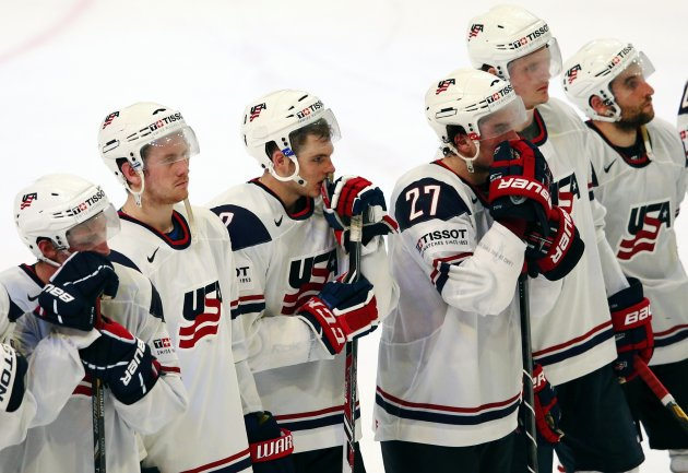Team USA's players react after their loss to Switzerland in their 2013 IIHF Ice Hockey World Championship semi-final match at the Globe Arena in Stockholm
