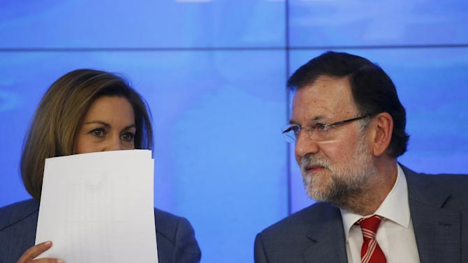 Spain's Prime Minister Mariano Rajoy (R) listens to People's Party (PP) Secretary General Maria Dolores de Cospedal at the beginning of a People's Party (PP) executive committee meeting at the party's headquarters in Madrid