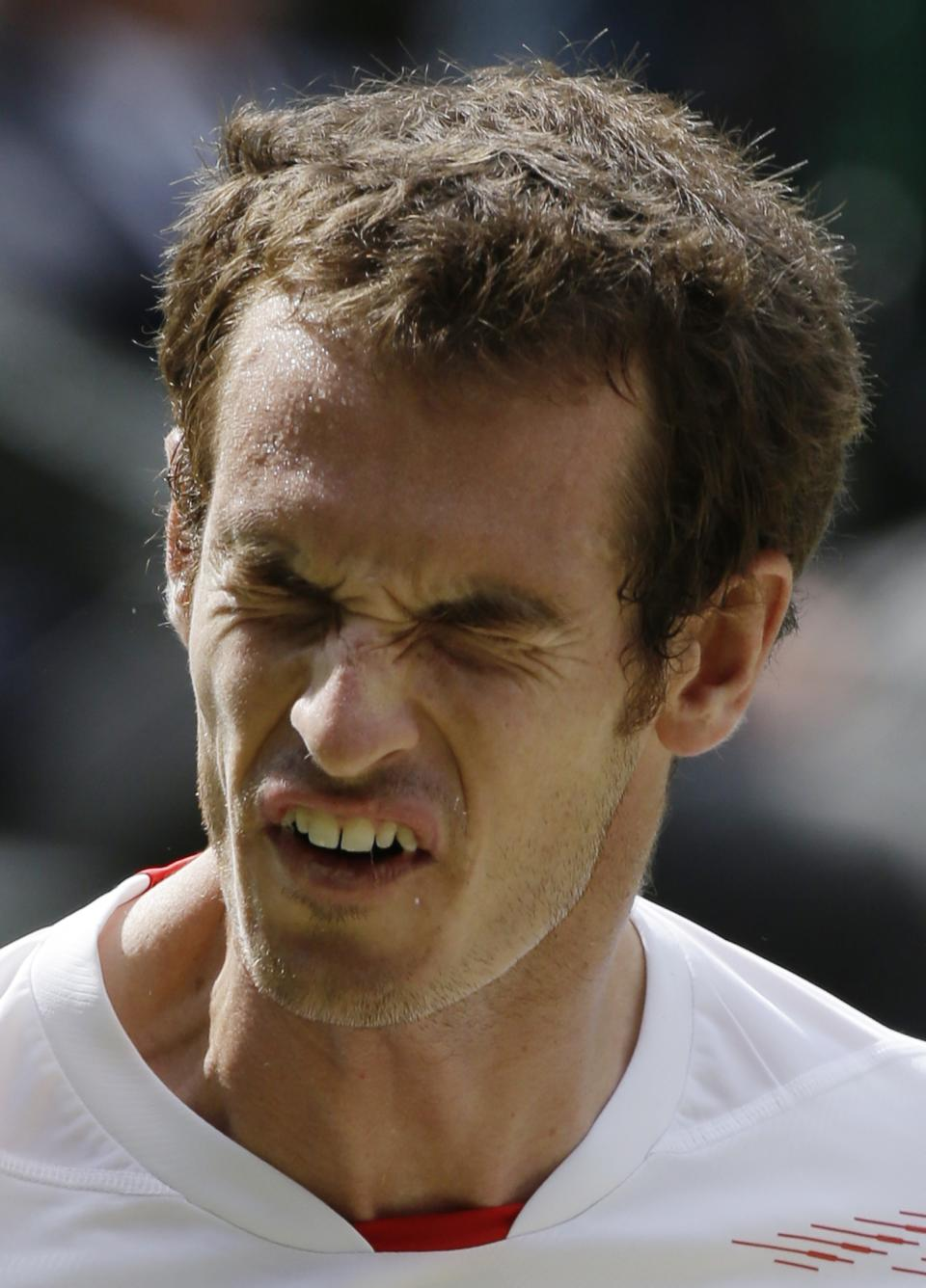 Andy Murray of Britain reacts during the men's singles final match against Roger Federer of Switzerland at the All England Lawn Tennis Championships at Wimbledon, England, Sunday, July 8, 2012. (AP Photo/Anja Niedringhaus)