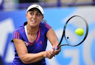 Tamira Paszek of Austria returns the ball during her women's final singles match against Angelique Kerber of Germany on the eighth day of the AEGON International tennis tournament in Eastbourne, southern England. Paszek won 5-7, 6-3, 7-5