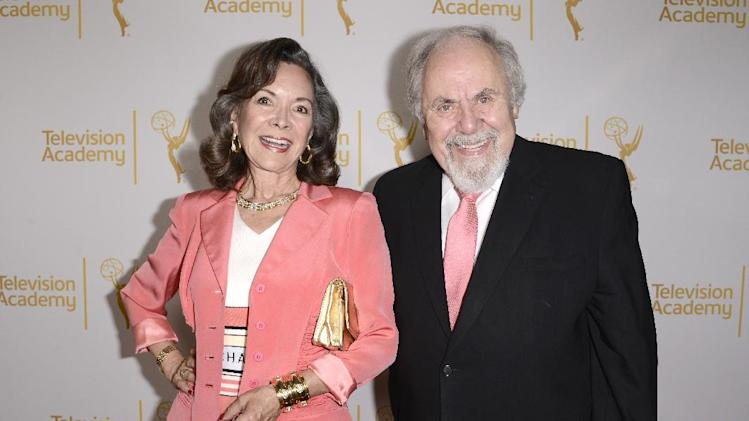 Jolene Brand, left, and George Schlatter arrive at the Television Academy's 66th Emmy Awards Producers Nominee Reception at the London West Hollywood on Friday, Aug. 22, 2014. (Photo by Dan Steinberg/Invision for the Television Academy/AP Images)