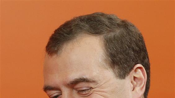 Russia's Prime Minister Dmitry Medvedev smiles during an interview with Reuters in Moscow