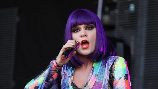 British singer Jessie J performs on stage with a broken leg, at V Music Festival in Hylands Park, Chelmsford, England, Saturday, Aug 20, 2011.  (AP Photo/Joel Ryan)