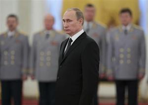 Russia's President Vladimir Putin attends a ceremony to present officers, who were recently appointed to senior command positions, at the Kremlin in Moscow