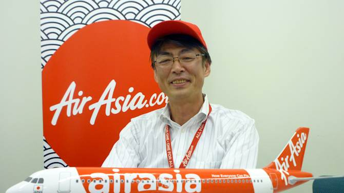 "In this Sept. 28, 2012 photo, AirAsia Japan President Kazuyuki Iwakata speaks during an interview in Tokyo. ""It's not that the meals on standard fares were ever free. The charge was just part of the ticket price,"" Iwakata told The Associated Press. ""With us, people pay only for what they need."" As a marketing ploy, AirAsia Japan, which started operations in August, offered tickets for just 5 yen (5 cents) to the first 10,000 people. They quickly sold out. (AP Photo/Yuri Kageyama)"