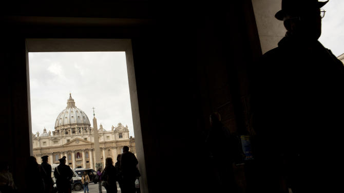 "St. Peter's Basilica is seen in the background as daily life returns to normal two days after Argentine Cardinal Jorge Mario Bergoglio was elected with the name of Pope Francis, Friday, March 15, 2013. Pope Francis has paid a heartfelt tribute to his predecessor Benedict XVI, saying his faith and teaching had ""enriched and invigorated"" the Catholic Church and would remain its spiritual patrimony forever. (AP Photo/Oded Balilty)"