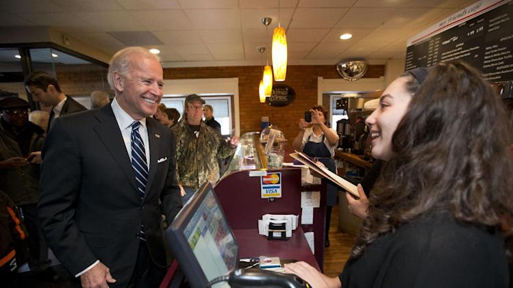 Vice President Joe Biden speaks with hostess Amira Nasrallah during his a visit to My Friends Cafe Sunday, Nov. 4, 2012, in Cleveland, Ohio. (AP Photo/Matt Rourke)