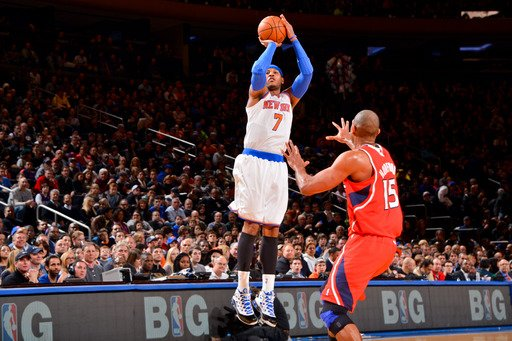 New York, NY - JANUARY 27: Carmelo Anthony #7 of the New York Knicks shoots a three-pointer against Al Horford #15 of the Atlanta Hawks at Madison Square Garden on January 27, 2013  in New York, New York. (Photo by Jesse D. Garrabrant/NBAE via Getty Images)
