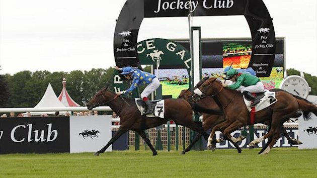 French jockey Antoine Hamelin (L), ridding Saonois 17, crosses the finish line during the French Derby (Prix du Jockey Club) on June 3, 2012 at Chantilly