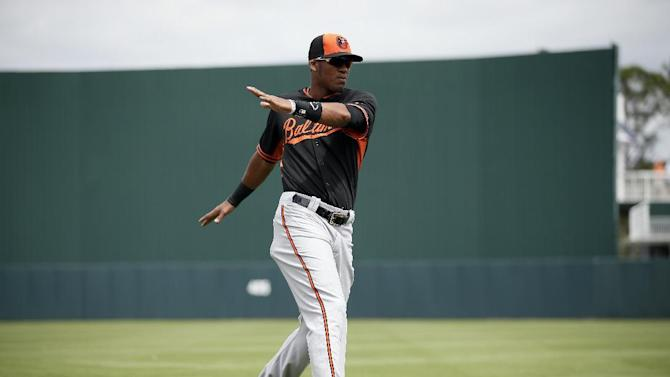 Baltimore Orioles' Jimmy Paredes stretches before the start of a spring training baseball game in Fort Myers Fla., Sunday March 8, 2015. (AP Photo/Tony Gutierrez)