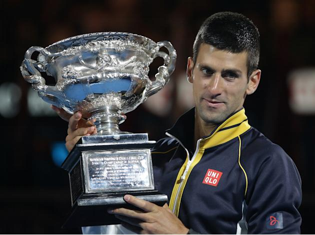 Serbia's Novak Djokovic holds his trophy after defeating Britain's Andy Murray in the men's final at the Australian Open tennis championship in Melbourne, Australia, Sunday, Jan. 27, 2013. (AP Photo/D