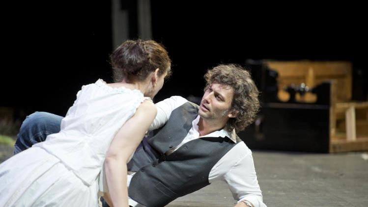 "In this undated photo provided by Alla Scala theater press office, Jonas Kaufmann, right, who plays Lohengrin, and Anja Harteros, playing Elsa, perform during rehersals of Richard Wagner's Lohengrin at the Milan La Scala opera house, Italy. The dual bicentennial of the births of composers Giuseppe Verdi and Richard Wagner is turning into a dueling bicentennial. La Scala general manager Stephane Lissner on Monday, Dec. 3, 2012 dismissed as ""ridiculous"" criticism by the Italian media because the famed Milan opera house that was once Verdi's musical home is opening the celebratory season with Wagner's ""Lohengrin."" No less than Italy's respected President Giorgio Napolitano entered the fray. He wrote a letter to musical director Daniel Barenboim rejecting press rumors that he was snubbing the gala season opener on Friday. (AP Photo/Monika Rittershaus, La Scala)"