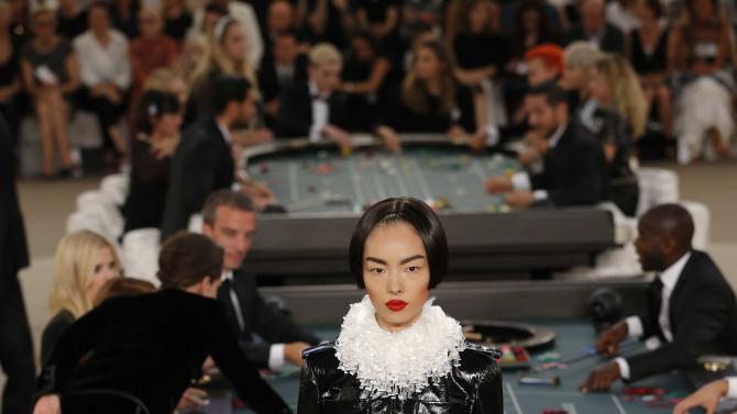 A model presents a creation by German designer Karl Lagerfeld as part of his Haute Couture Fall Winter 2015/2016 fashion show for French fashion house Chanel at the Grand Palais in Paris