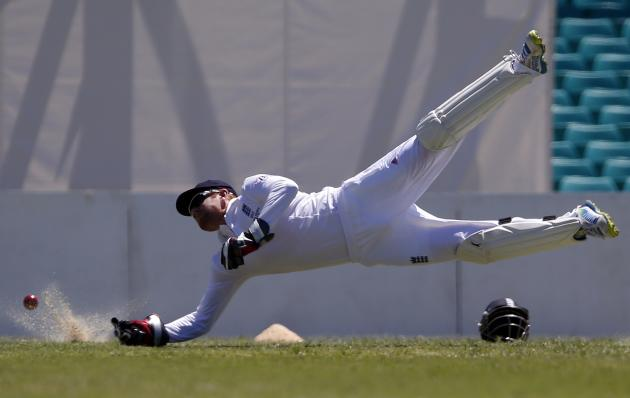 England's wicketkeeper Bairstow dives at he attempts to take a catch from Cricket Australia Invitational XI player Patterson during their warm-up match at the Sydney Cricket Ground