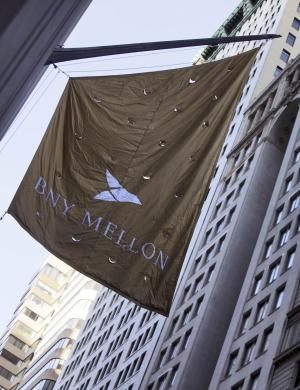 FILE - In this file photo taken April 19, 2010, a Bank of New York Mellon banner hangs from their building in New York. Bank of New York Mellon Corp. said Tuesday, Oct. 19, 2010, its third-quarter net income fell, pinched by acquisition and restructuring costs. (AP Photo/Richard Drew, file)